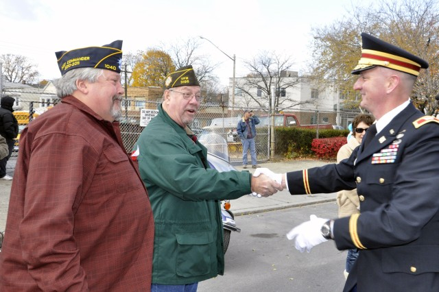 Arsenal Commander Col. Mark F. Migaleddi takes a moment during the parade to thank Veterans who lined the parade route.
