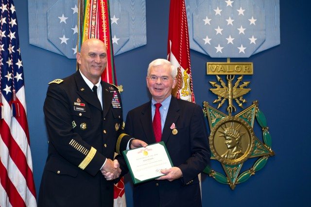 """U.S. Army Chief of Staff Gen. Raymond T. Odierno presents The Outstanding Civilian Service Medal to retired Gen. William F. """"Buck"""" Kernan, Board Member Patriot Foundation, during an award ceremony at the Hall of Heroes in the Pentagon, D.C. Nov. 29, 2011."""
