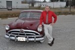 Classic car enthusiast keeps it moving down the road