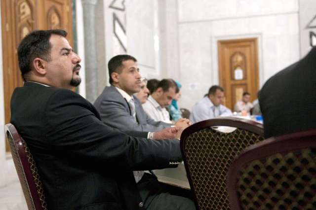 "Managers from eight of Iraqi's leading banks listen to the opening remarks of the ""Banking on Iraqi Business"" conference hosted by the 15th Financial Management Company at Al Faw Palace in Baghdad, June 1, 2010. The focus of the meeting was the important role electronic funds transfer and modern core-banking systems play in strengthening Iraqi's economy."