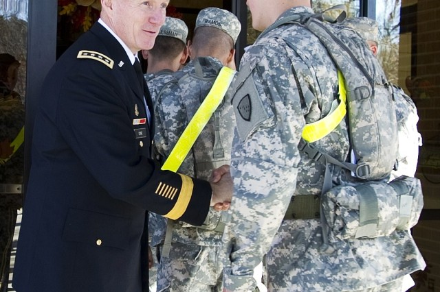 Gen. Robert W. Cone, commanding general of U.S. Army Training and Doctrine Command, greets soldiers as they enter Resolute Cafe on Fort Eustis, Va., Thanksgiving Day.