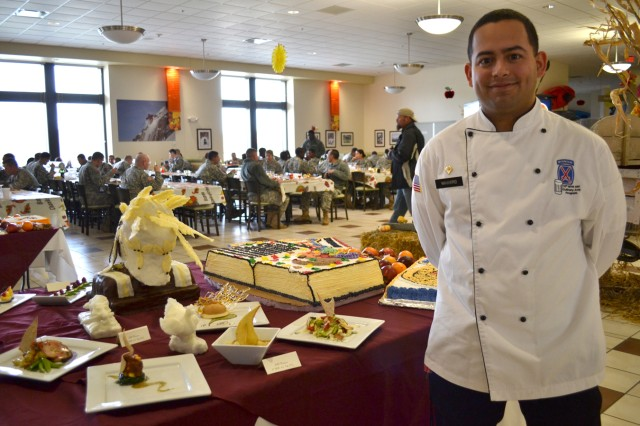 Spc. David Francisco Navaro, a food specialist in 210th Brigade Support Battalion, 2nd Brigade Combat Team, stands next to his Thanksgiving creations at the Riva Ridge Dining Facility on Nov. 22.