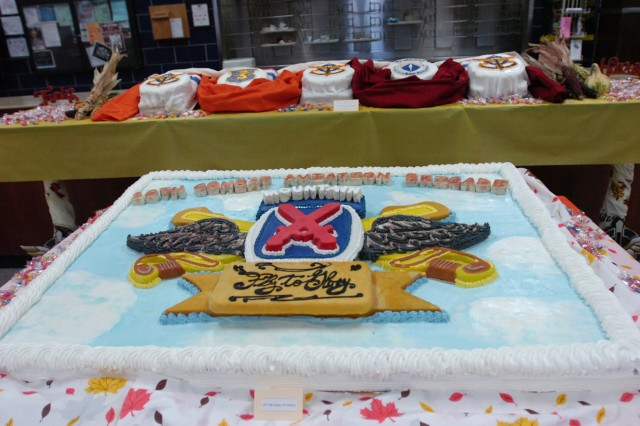 A cake inspired by the unit crest of Task Force Falcon, 10th Combat Aviation Brigade, was displayed Nov. 22 at the entrance of the Aviation DFAC. It was created by Pfc. Nabeel Hameed, a food service specialist with 2nd Battalion, 22nd Infantry Regiment, 1st Brigade Combat Team.