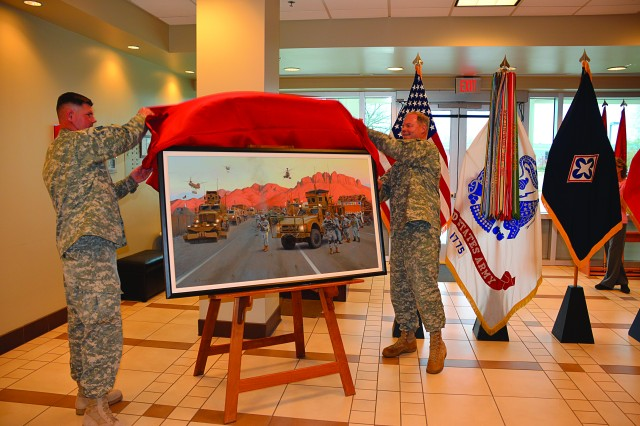 FORT LEE, Va. (Dec. 1, 2011) -- Col. Todd Heussner, 43rd Sustainment Brigade commander, and Maj. Gen. James L. Hodge, U.S. Army Combined Arms Support Command and Fort Lee commanding general, unveil a painting that was commissioned by the brigade after the completion of its deployment to Kandahar, Afghanistan as part of an increase of troops announced in December 2009.  The painting was presented to CASCOM -- the Home of Sustainment -- to honor and recognize the accoplishments of all sustainment Soldiers who have served in support of Operation Enduring Freedom, said Hodge.
