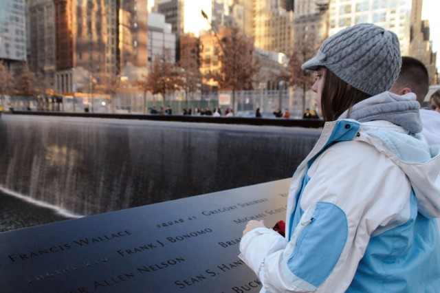 Kimberly Rhodes, Fort Drum Family Member, pauses in front of one of the 9/11 Memorial's twin reflecting pools. Each pool is nearly an acre in size. They are the largest man-made waterfalls in North America.