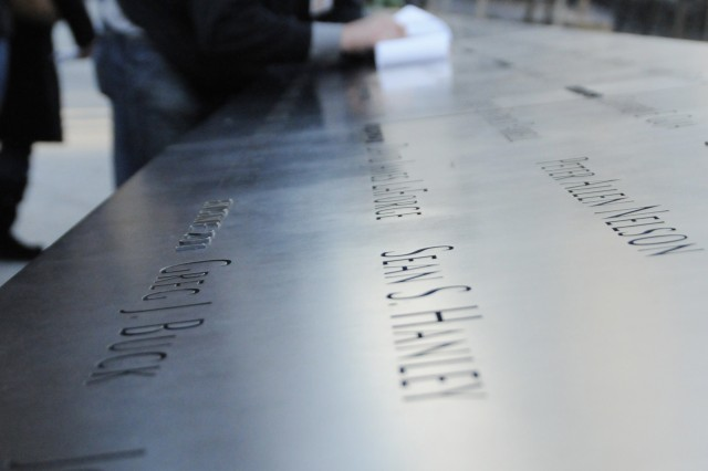 A visitor at the 9/11 Memorial uses a pencil and paper to make a rubbing of an engraved name Thursday. The memorial, which opened in September, is a tribute to the men, women and children killed in the terrorist attacks Sept. 11, 2001, at the World Trade Center, in a field near Shanksville, Pa., and at the Pentagon, and during the bombing of the World Trade Center on Feb. 26, 1993.