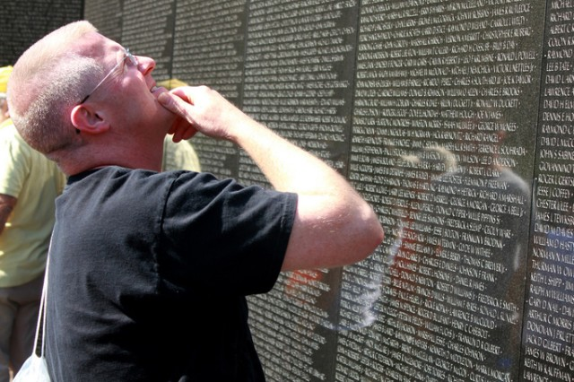 Lt. Col. Mark A. Leighton, HHC 412th Theater Engineer Command  searches for his father's name on the Vietnam Memorial wall. Leighton was in D.C. to participate in the 27th Annual Army 10-Miler race October 8, 2011.  (U.S. Army photo by: Staff Sgt. Paul Roberts, 314th Public Affairs Operations Center)