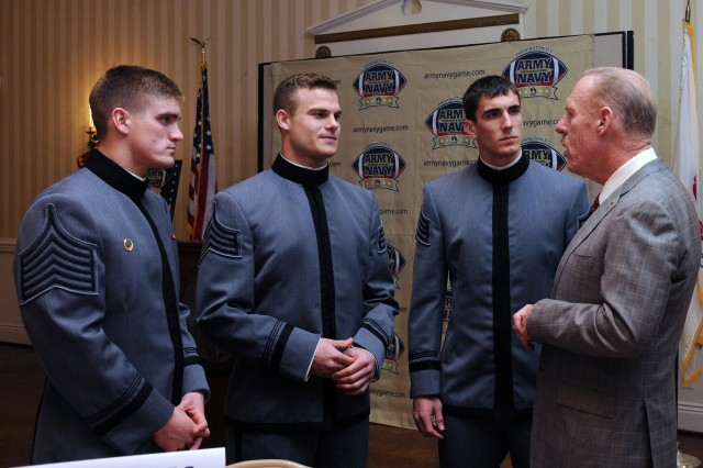 From left, Army Black Knights team captains Max Jenkins, Steve Erzinger and Andrew Rodriguez meet with retired Lt. Gen. Stephen M. Speakes before their luncheon at the Army Navy Country Club in Arlington, Va.