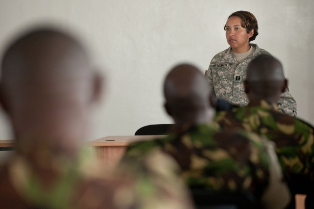 "U.S. Army Capt. Enilda Flores-Cabrera, 402nd Civil Affairs Battalion training team chief and mission commander, addresses 19 Kenyan Army engineers following a five-day civil affairs field training exercise in Embakasi, Kenya. ""Civil Affairs is important in every climate,"" said Flores-Cabrera. ""We use negotiation, mediation and assessment to get a better understanding of how to approach the issues at hand and how we can resolve it."" Photo by ."