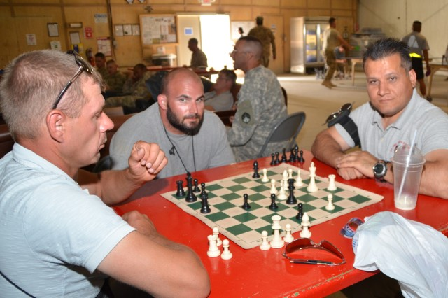 Customers relax in an MWR facility operated by LOGCAP contractor DynCorp International at Kandahar Airfield. The facility offers pool and ping-pong tables, music rooms, reading rooms, televisions and a chance to relax for a few minutes.