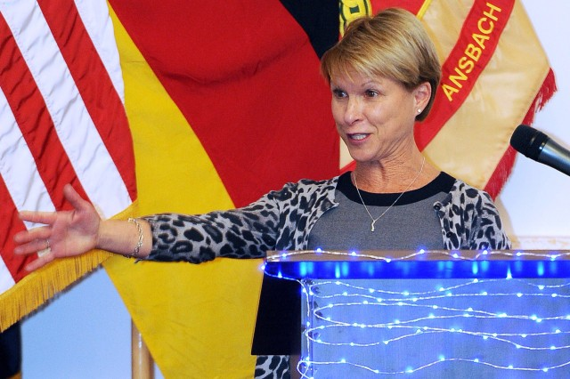 Sue Hertling, featured speaker for the U.S. Army Garrison Ansbach grand finale celebration of the Month of the Military Family and wife of USAREUR Commanding General Lt. Gen. Mark P. Hertling, addresses the crowd of attendees.
