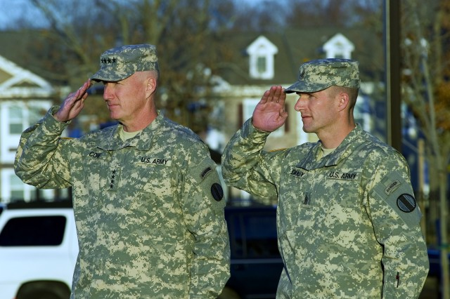 Gen. Robert W. Cone, commanding general of U.S. Army Training and Doctrine Command, and Command Sgt. Maj. Daniel A. Dailey, TRADOC command sergeant major, salute the colors as the flag is lowered during the Welcome Ceremony held for Dailey on Fort Eustis, Va., Dec. 1, 2011