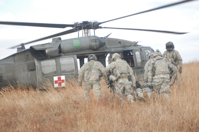 Soldiers from Apache Troop, 1st Squadron, 4th Cavalry Regiment, conduct a medical evacuation by Blackhawk helicopter during their urban cluster training exercise, Dec. 1