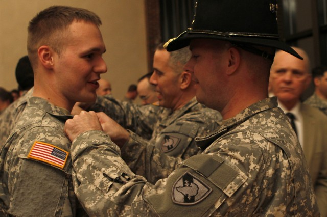 Class of 2012 Cadet Kyle Johnson receives Aviation branch insignia during Branch Night at Eisenhower Hall, at the U.S. Military Academy at West Point, N.Y., Dec. 1, 2011.