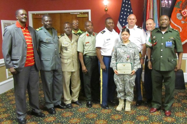 Staff Sgt. Piedad Garcia, former information management specialist for U.S. Army Africa (USARAF) G-6, poses for a photo with members of a touring African Signal officers group after receiving the Meritorious Service Medal from Brig. Gen. Joseph Kwankye, Director General of Defence Communications and Information Systems of the Ghanaian Army, in a ceremony at Fort Gordon, Ga., recently.