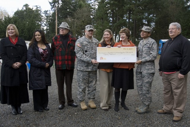 "Coinciding with the ""Trees for Troops"" arrival, America's Credit Union will present $30,000 to several agencies and organizations serving JBLM service members and their families. Representatives from the Madigan Foundation; Santa's Castle toy donation program, JBLM ACS Food Basket Program, and Reflection Park Fund  accepted checks on behalf of their respective organizations. The funds were raised during the credit union's 11th Annual Holiday Troop Support Golf Tournament, conducted by Nov. 4 at Eagles Pride Golf Course on JBLM."