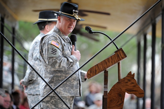 Lt. Gen. Rick Lynch, the former commanding general of Installation Management Command, gives an address at the Departure and Retreat Ceremony honoring himself and Command Sgt. Maj. Neil Ciotola, the former IMCOM command sergeant major, Dec. 1, 2011, on Cooper Field at Fort Hood, Texas.