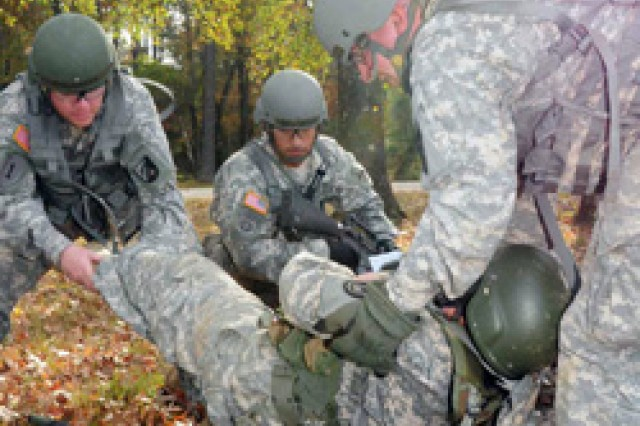 During a simulated exercise, Soldiers practice evacuating an injured Soldier during the first multi-component Warrior Leader Course at the Camp Beauregard Range Complex hosted by the Louisiana National Guard, Nov. 15, 2011. The Louisiana Guard provided training for National Guard, Reserve and active-duty Soldiers from Fort Polk, Nov. 4-18, 2011.