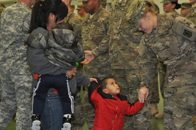 """FORT LEONARD WOOD, Mo. """" Victor Lopez, 5, shakes the hand of a military police Soldier during a deployment ceremony Dec. 5 at Nutter Field House. Victor's father, Pfc. Sergio Lopez, is assigned to the 463rd Military Police Company which is slated to deploy in support of Operation Enduring Freedom this year."""