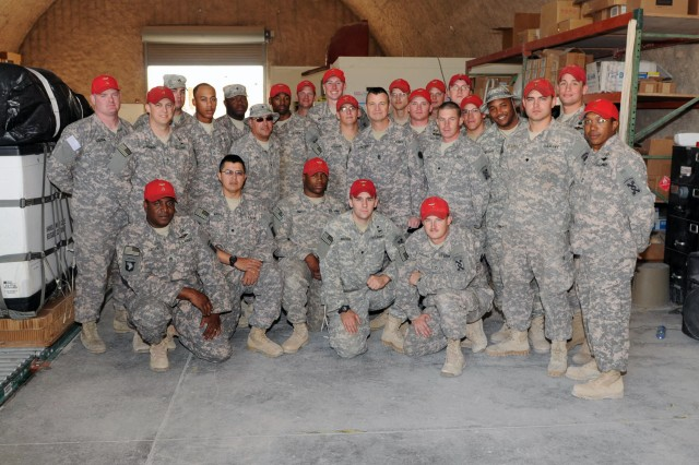 SOUTHWEST ASIA - Command Sgt. Maj. Stephan Frennier, Third Army/ARCENT senior enlisted advisor and Whitehouse, Texas native, poses for a group photo with Parachute Riggers with the U.S. Army Reserve, 421st Quartermaster Company, Ft. Valley, Ga., here Dec. 3. Third Army remains committed to offering Soldiers outstanding leadership. Through visiting the region, Command Sgt. Maj. Frennier is helping to motivate, mentor and guide Soldiers, the strength of our nation.