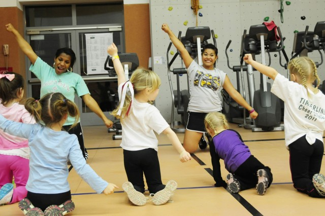 VHS cheerleaders teach pint-sized cheer enthusiasts a new dance routine.