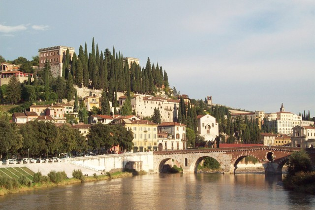 An ancient Roman bridge leads to the Castle Saint Peter and the Roman Theater and offers spectacular views of the romantic and culturally unique city of Verona.