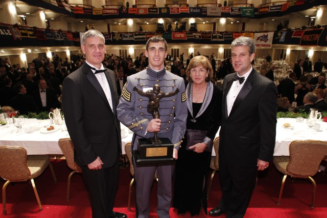 United States Military Academy linebacker Andrew Rodriguez was named the 22nd recipient of the William V. Campbell Trophy at the 54th National Football Foundation Annual Awards Dinner in New York City, Dec. 6, 2011. Cadet Rodriguez pauses for a photo with his father (left) Gen. David Rodriguez, commander of U.S. Army Forces Command, his mother Ginny Rodriguez, and Army Athletic Director Bob Corrigan.