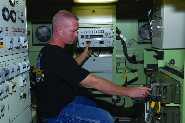 Electronics Mechanic David Walsh performs an operational test of an AN/TRC-190 radio system for a quality inspection at Tobyhanna Army Depot, Pa.  Depot personnel have improved visual management within the shop by placing parts and administrative tools within easy reach of technicians in work areas, which has improved efficiency and flexibility, allowing Tobyhanna personnel to take on more workload to meet customer needs.