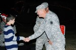 DCG-IMT shakes child's hand at Eustis tree lighting ceremony
