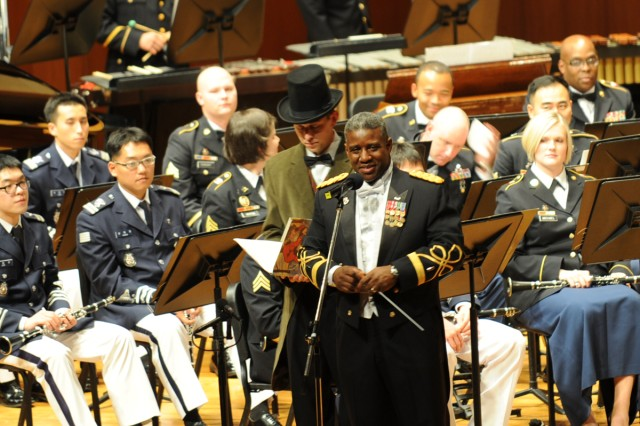 The Eighth Army Band will perform with Korea's 90 Violin Orchestra, Soprano Shin Young-ok and Baritone Seo Jung-haak during their annual holiday concert at the Seoul Performing Arts Center, South Korea, Dec. 18, 2011.
