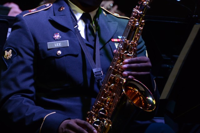 Spc. Darrell Lee, a saxophone player with the 282nd Army Band, performs during the band's holiday concert Sunday at the Solomon Center. The concert featured a blend of holiday favorites, including numerous jazz and rock renditions.