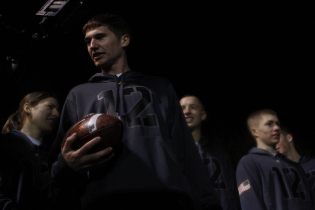 Class of 2013 Cadet Colin Chapman, men's captain on the West Point Marathon Team, receives the game ball from the Black Knights co-captains during a spirit rally on Daly Field at the U.S Military Academy at West Point, N.Y., Dec. 7, 2011. The mission -- one which the Marathon Team has upheld for nearly three decades now -- is to run the football from West Point to the Army-Navy game site. This year, the team will run about 280 miles to FedEx Field in Landover, Md. The marathoners added a significant detour to the trip when they passed the World Trade Center site in New York City to honor fallen graduates from both service academies.