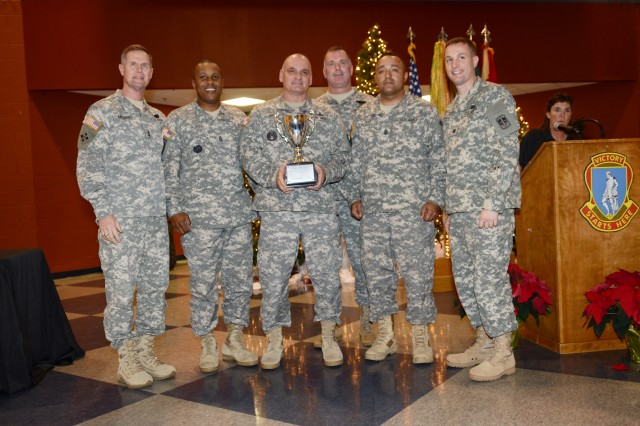 Soldiers with the 120th Adjutant General Battalion show off the Commander's Cup trophy after being awarded at the annual sports banquet Tuesday.