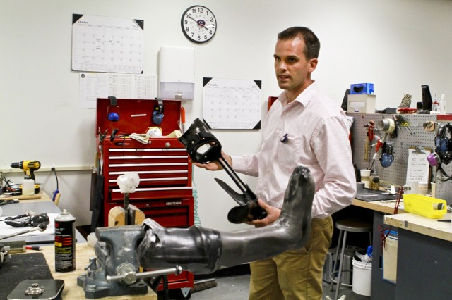 Ryan Blanck, a prosthetist and developer of the Intrepid Dynamic Exoskeletal Orthosis, discusses how he makes the device in his lab at the Center for the Intrepid in San Antonio, Nov. 9, 2011. The brace reduces pain for Soldiers who suffered lower leg injuries and increases mobility, including the ability to run.