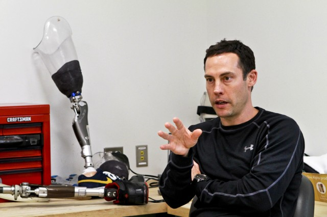 Johnny Owens, a physical therapist, discusses the brace's benefits for wounded warriors at the Center for the Intrepid in San Antonio, Nov. 9, 2011.