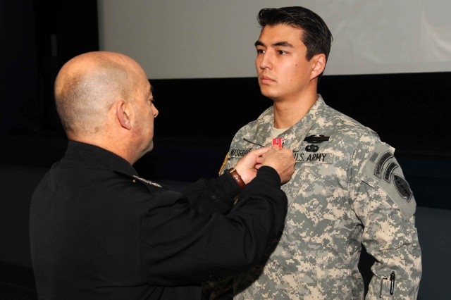 U.S. European Command Commander Adm. James G. Stavridis pins the Bronze Star with Valor device on Staff Sgt. Jeffery Musgrave during a Valor Ceremony hosted by U.S. Special Operations Command Europe on Dec. 6, 2011, in Stuttgart, Germany. Musgrave, a U.S. Army Special Forces Soldier assigned to 1st Battalion, 10th Special Forces Group (Airborne), received the fourth-highest award for gallantry in combat for his heroic actions on May 17, 2010, in Wardak Province, Afghanistan