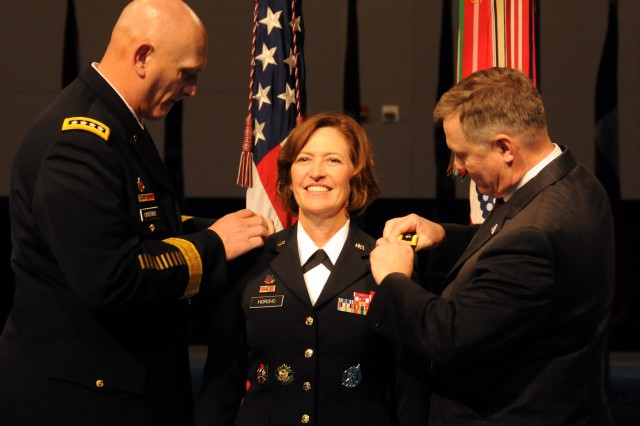 Gen. Raymond T. Odierno, Army chief of staff, and retired Col. Ray Horoho, her husband, pin the three-star epaulets on the shoulders of Lt. Gen. Patricia D. Horoho, the 43rd surgeon general and commanding general of the U.S. Army Medical Command, in Dec. 7, 2011, ceremony at Joint Base Myer-Henderson Hall in Arlington, Va.