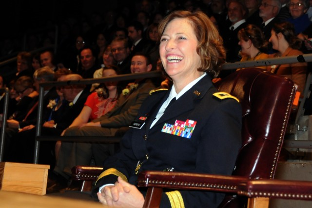 Maj. Gen. Patricia D. Horoho enjoys Army Chief of Staff Gen. Raymond T. Odierno's remarks before getting her third star.