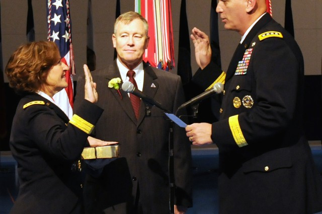 Lt. Gen. Patricia D. Horoho is sworn in as 43rd Army surgeon general by Army Chief of Staff Gen. Raymond T. Odierno, while her husband retired Col. Ray Horoho looks on.