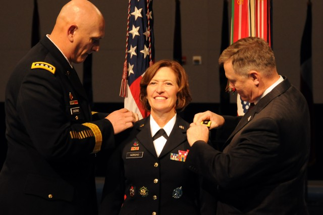 Gen. Raymond T. Odierno, Army chief of staff, and retired Col. Ray Horoho, her husband, pin the three-star epaulets on the shoulders of Lt. Gen. Patricia D. Horoho, the 43rd surgeon general and commanding general of the U.S. Army Medical Command, in Dec. 7, 2011, ceremony at Joint Base Myer-Henderson Hall in Arlington, Va.,
