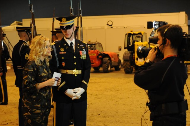 Capt. Christopher Miorin, 3d U.S. Infantry Regiment (The Old Guard), U.S. Army Drill Team, Commander, speaks to Anna Williamson of ITV's Daybreak show about the British Military Tournament Dec. 1, 2011.
