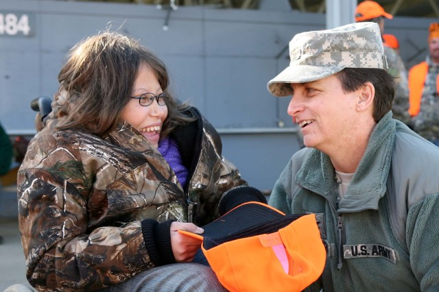 Seventeen year old Arianna Evans of Tionesta, Pa. talks with LEAD Depot Commander, Col. Cheri A. Provancha, after a morning of hunting at Letterkenny Army Depot in Chambersburg, Pa. on Friday, Dec. 2, 2011. This is Evans second Hunt of a Lifetime experience; at the age of 13 she went on a turkey hunt in South Dakota.