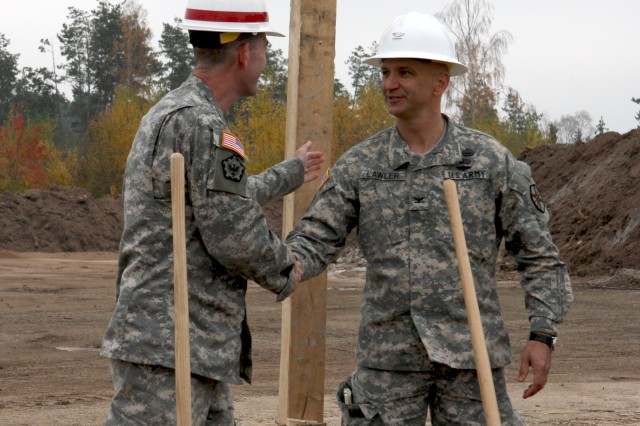 Col. D. Peter Helmlinger (left), U.S. Army Corps of Engineers Europe District commander, congratulates Col. Kelly Lawler, U.S. Army Garrison Ansbach commander, on a successful groundbreaking for the future Auto Skills Center facilities Nov. 4, 2011, at the Urlas Family Housing Area, Germany. The $6 million facility will provide nine bays for auto maintenance and a car wash building. A vehicle storage area, stripping yard, dog wash and oil-water separating system are all included in the plans. (U.S. Army Corps of Engineers photo by Rachel Goodspeed)