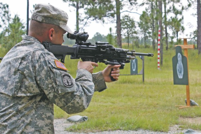 Spc. Timo Swaner engages a close range target with a prototype light machine gun during a military unit assessment at Fort Benning, Ga.