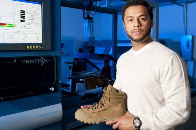 Ben Cooper, footwear project engineer in the Footwear Performance Laboratory at Natick Soldier Systems Center, holds one of the new Hot Weather Mountain Combat Boots.