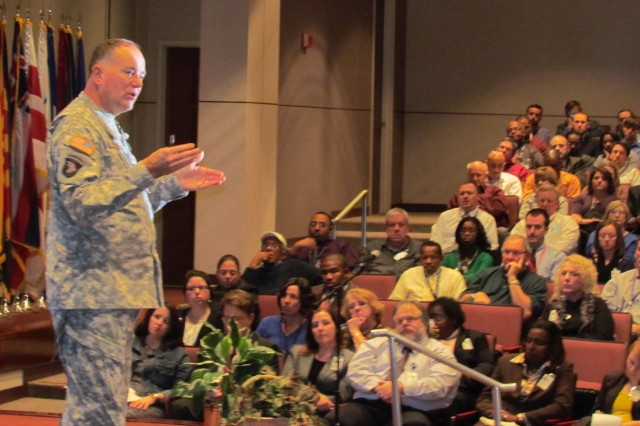 Maj. Gen. Jim Rogers, commander of the Aviation and Missile Command, addresses a filled Bob Jones Auditorium during the Nov. 30 town hall.