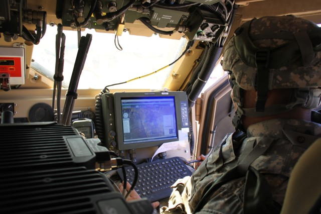 "A 2nd Brigade, 1st Armored Division Soldier uses the Joint Capabilities Release of Force XXI Battle Command Brigade and Below/Blue Force Tracking during the Army's Network Integration Evaluation 12.1. JCR provides a ""bridge"" to Joint Battle Command-Platform, which will bring features such as detailed touch-to-zoom maps and drag-and-drop icons as well as a new level of situational awareness for dismounted Soldiers."
