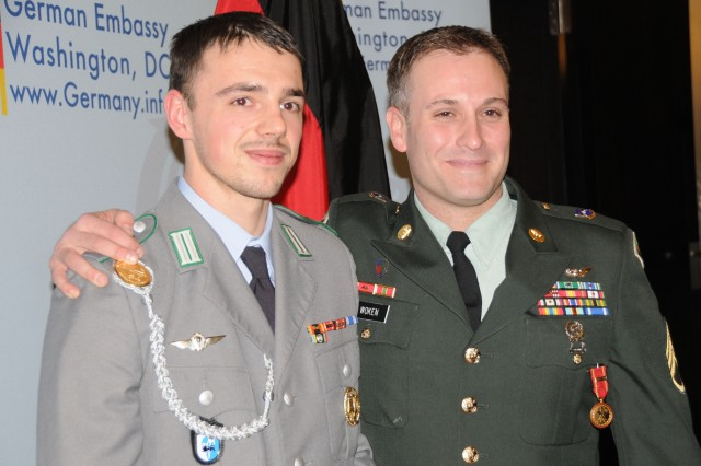 German Cpl. Tim Focken and Staff Sgt. Peter Woken meet following a ceremony, Dec. 8, 2011, at the home of the German ambassador in Washington, D.C.  During the event, Woken was awarded the German Medal of Honor for Gallantry in Action, which is similar to the American Silver Star, for saving Focken's like in Afghanistan.