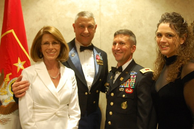 From left to right Mrs. Jeanne Chandler, Sgt. Maj. of the Army Raymond F. Chandler III, Capt. Steven M. Gerber, commander, Gulf Company, 626th Brigade Support Battalion, 3rd Brigade Combat Team, 101st Airborne (Air Assault) and Miss Jennifer Turpin, gather for photo.