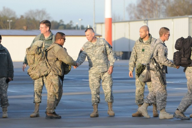 Leaders from 5th Signal Command welcome home Soldiers from 44th Expeditionary Signal Battalion as they exit the plane ending their deployment to Afghanistan.
